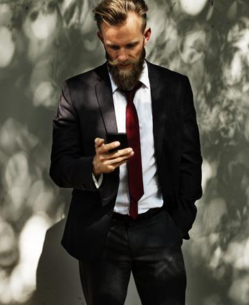 Suited man using mobile responsive website